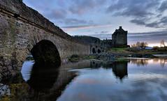 Eilean Donan castle (UndaJ) Tags: sunset castle reflections island scotland highlands eilean donan