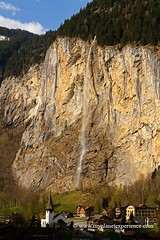 Lauterbrunnen and Staubbach Falls (My Planet Experience) Tags: blue sky panorama mountain alps church rock landscape schweiz switzerland waterfall scenery village suisse falls alpine svizzera lauterbrunnen ch staubbachfalls wwwmyplanetexperiencecom myplanetexperience