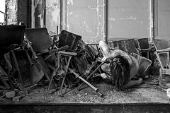 Angle of Repose (sadandbeautiful (Sarah)) Tags: school bw woman selfportrait abandoned me female self chairs pa auditorium urbex jwcooper