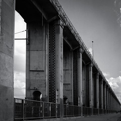 Adventures in Film (Shooting Ben) Tags: light blackandwhite bw film scale coffee wall clouds contrast mediumformat dark concrete shadows natural australia victoria structure 120film size huge manmade yashica weir yashicamat leadinglines caffenol lakehume caffenolc