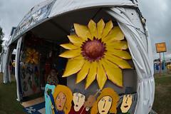 Pat Juna flower (Scott Saltzman / Barefoot Photography) Tags: flower art yellow metal fairgrounds gloom marketplace day4 neworleansjazzandheritagefestival patjuno