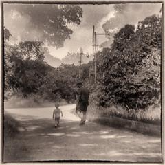 Father and Son (arubio10) Tags: trees boy blackandwhite film clouds walking kodak path doubleexposure father son windmills brownie hawkeye filmisnotdead arista200