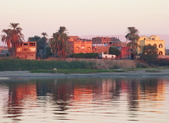 Morning Building Reflections on the Nile River (shaire productions) Tags: city travel mountain lake reflection building nature water beauty river wonder scenery cityscape image country egypt picture scene calm nile zen egyptian simple giza valleyofthekings worldtravel travelphotography luxur egyptandthenile contikiegypt