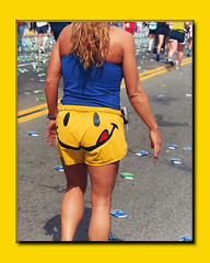 The Face of the Marathon (The Bop) Tags: street smile paper outdoors tan tshirt sneakers cups shorts