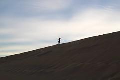 Waving Hello (daveynin) Tags: sunset shadow walking sand desert nps hiking dunes deathvalley asl marlena