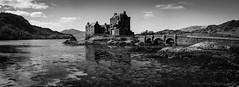 Eileen Donan Castle panorama (jasonmgabriel) Tags: bridge bw white black mountains building castle water monochrome clouds landscape scotland scenery highlander hills loch eileen donan