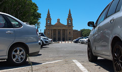 St. Publius Church (Steve Millward) Tags: summer vacation holiday cars church 35mm island town interesting nikon mediterranean scenic july sunny bluesky malta sharp nikkor prespective comino hotweather floriana captial primelens fixedfocallength d7100 stpubliuschurch stevemillward