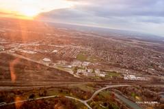 Niagara Sky Shot 4 (ismailwilliams) Tags: city bridge sunset sky usa sun mist ny newyork canada water canon buildings river landscape flow happy fly us stream glare shine niagara falls helicopter land rays damm maiden 60d