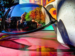 In Sun (splinx1) Tags: hdr sunglasses shades coffeecup canonpowershotelph330hs red yellow blue black green white light shadow selfportrait reflection canonart pocketcamera miniaturephotography linnaeas heatwave patio coffeeshop chdk modernart mcescher