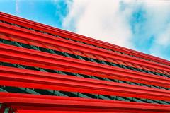 red (aperture one) Tags: red sky urban building berlin rot architecture clouds facade analog germany deutschland europa europe geometry himmel wolken architektur fujifilm analogue gebäude nikonfg geomtrie urbantopography fujifilmsuperiaextra200