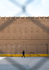 boy playing football in front of the old rampart, Central County, Kerman, Iran (Eric Lafforgue) Tags: boy people history childhood vertical wall architecture ball outdoors photography persian football kid ancient asia child iran fort persia architectural historic historical iranian sight fortification kerman oneperson middleeastern rampart  placeofinterest  childrenonly 1people  iro  builtstructure centralcounty colourpicture  boyonly irandsc07234