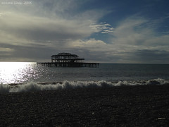 Old Brighton Pier (vicky_liney) Tags: beach water clouds fire brighton waves pebbles shore oldpier