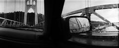 Where I'll go, where I've been (Zeb Andrews) Tags: bridge panorama film car oregon 35mm portland blackwhite driving pano panoramic rainy transportation pacificnorthwest kodaktrix swinglens analogphotography stjohnsbridge homagetoleefriedlander wideluxf7