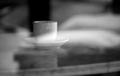 A Coffee Cup (John Bense) Tags: blackandwhite reflection cup window coffee monochrome ceramic table drink coffeecup coffeeshop reflect starbucks storefront caffeine hotdrink