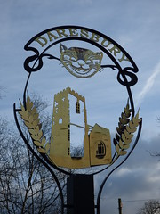 Chester Road, Daresbury - village sign - Cheshire Cat and All Saints Church (ell brown) Tags: greatbritain trees england tree sign village cheshire unitedkingdom aliceinwonderland cheshirecat lewiscarroll allsaintschurch daresbury halton villagesign alicethroughthelookingglass churchofallsaints chesterrd allsaintschurchdaresbury daresburyvillage daresburyconservationarea churchofallsaintsdaresbury chesterrddaresbury