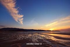 Deep (Xacobe Casal) Tags: sunset beach clouds sand playa puestadesol nigrn playaamrica