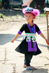 Girl in ethnic costume, Hmong village near Luang Prabang, Laos (inchiki tour) Tags: road street portrait people girl photo alley asia southeastasia village embroidery traditional cloth laos ethnic luangprabang hmong stitchwork    louangphrabang