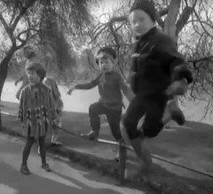 Jumping around (theirhistory) Tags: girls lake boys water grass hat fashion children clothing pond russia path cap 1960s wellies wellingtons sovietunion ussr cccp englandlondon