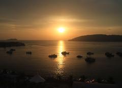 Sunset in Malaysia (` Toshio ') Tags: sunset sea reflection boats island asia palmtrees shore malaysia borneo 7d kotakinabalu fishingboats sabah southchinasea toshio