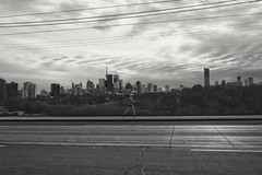 Running on Air (Natalie Markiewicz) Tags: blackandwhite toronto monochrome streetphotography broadview ruuner riverdaleparkeast carlzeissbiogon2528zm
