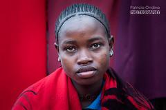 Saleswoman on a market - Vendeuse sur un march (Patricia Ondina) Tags: africa red woman rot canon rouge colorful colours couleurs femme ethiopia color afrique sulky travelphotography ethiopie coulourful boudeuse photosdevoyage