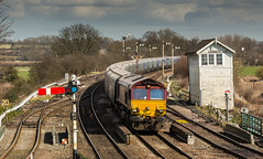 DB Schenker Class 66 no 66063 approaches Barnetby past the now disappeared semaphore signals on 24-03-2015 (kevaruka) Tags: uk greatbritain england sun colour history sunshine composition digital train canon march flickr colours unitedkingdom yorkshire transport rail railway sunny trains historic lincolnshire signals telephoto trainstation gb 5d locomotive fullframe past frontpage britishrail semaphore humber sunnyday dbs signalbox southyorkshire freightliner 2015 networkrail railfreight barnetby railnetwork dbschenker canon5dmk3 5dmk3 5d3 5diii 24032015 thephotographyblog canon70200f28ismk2 canoneos5dmk3