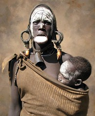 Mursi woman and baby (Linda DV) Tags: africa park street travel portrait people face canon geotagged candid culture tribal clothes national ethiopia tribe ethnic minority mago mursi 2010 ethnology travelphotography travelportrait powershots5is minorité minderheid lindadevolder picmonkey