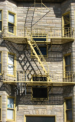 fire escape 2 (lisafree54) Tags: yellow stone architecture stairs fire pattern shadows escape gray free staircase fireescape cco freephotos
