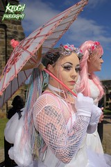 IMG_9309 (Neil Keogh Photography) Tags: pink flowers blue white green abbey graveyard yellow dreadlocks female umbrella fence shoes purple candy boots lace bra gothic goth goggles trainers tattoos gloves corset braids spikes gravestones tutu choker cybergoth whitbyabbey dogcollar fishnettights whitbygothweekend fishnettop april2016