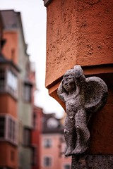 Guardian Angel (galvanol) Tags: sculpture stone angel austria bokeh oldtown tyrol innsbruck canon135mm galvanol