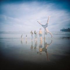 Cartwheel Double Exposure (lomokev) Tags: people green beach pier lomo sand brighton doubleexposure cartwheel brightonpier palacepier lomogaphy lca120 lomolca120 file:name=150730lomolca120kodakvc000009 roll:name=150730lomolca120kodakvc