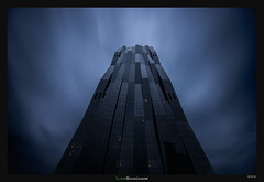 The Tower of Darkness (Ilan Shacham) Tags: vienna wien longexposure sky abstract tower architecture modern clouds dark austria graphic geometry menacing fear fineart streaking fineartphotography frightening perrault dominiqueperrault dctower