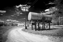 Oil Tank Monochrome (Notley) Tags: sky blackandwhite usa monochrome clouds rural america landscape midwest oiltank 10thavenue midamerica americanlandscape notley ruralphotography fayettemissouri boonecountymissouri notleyhawkins howardcountymissouri missouriphotography httpwwwnotleyhawkinscom notleyhawkinsphotography