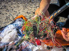 Trying to sort out the mess of kite lines after the kite spent a night in the ocean.