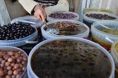 Olives seller, Baghdad, Iraq (Ameer Hamza) Tags: food man retail fruit iraq tourist olives baghdad variety seller iraqi visa complete pilgrim traveler 2015 ziarat ameerhamzaadhia ameerhamzaphotography travelsiniraq