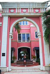 The Girl at the Fountain (Poocher7) Tags: pink fountain architecture glasses florida 5thavenue skirt palmtrees blonde naples prettywoman pinkbuilding