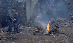 Let's start a fire (theirhistory) Tags: uk boy england cinema film fire kid shoes child kinderen burning jacket trousers wellies newsreel