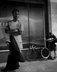 Three Figures and a Bicycle (stevedexteruk) Tags: street uk woman london window bike bicycle sport reading newspaper football display muslim hijab nike cycle niqab regent eveningstandard 2016 khimar