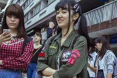 gales ferry (edwardpalmquist) Tags: street city travel people urban woman girl fashion japan shopping army tokyo phone crowd shibuya jacket harajuku pigtails