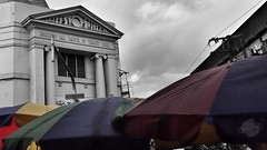 (40emem) Tags: road street old city bw color colour building art heritage umbrella fun lumix flickr day philippines sunday olympus bnw f25 ep3 leyte m43 tacloban 14mm mft