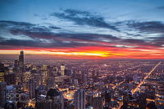 Sunset in Chicago (Justin S Reid) Tags: street city travel blue light sunset sky urban usa chicago building architecture night clouds illinois long exposure cityscape nightscape aerial fromabove megapolis scyscrapers 500px ifttt dierjscreensaver