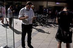 . (www.piotrowskipawel.pl) Tags: street city light shadow people man apple mobile germany mnchen bayern cityscape crowd streetphotography documentary cigar applestore wifi tab decisivemoment documentaryphotography colorstreetphotography pawepiotrowski piotrowskipawelpl