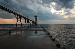 Eye of the Storm (Aaron Springer) Tags: sunset lighthouse storm reflection nature landscape pier spring twilight outdoor michigan lakemichigan maritime nautical stormclouds manistee northernmichigan thegreatlakes manisteelighthouse manisteenorthpierheadlight