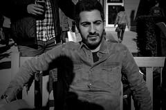 Sitting in my shadow (Hans Dethmers) Tags: blackandwhite man monochrome flickr sitting fuji hansdethmers
