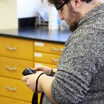 A student in the tweetspeak cluster examining his binoculars