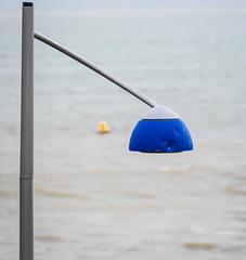 Lamp at Newtons Cove (dorsetpeach) Tags: blue light england lamp yellow streetlamp dorset weymouth buoy newtonscove