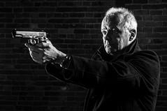Detlef (Nikon Yves) Tags: blackandwhite monochrome pistol sincity