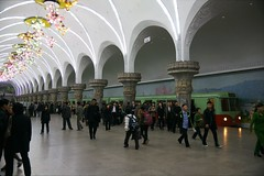 Yongwang Metro station during rush hour (Frhtau) Tags: life people woman colour station del train underground walking asian outdoors photography clothing asia do day republic leute exterior image metro propaganda glory background capital north culture scene korea daily peoples riding korean ubahn casual inside asie tradition coree slogan democratic nord norte lifestyles pyongyang goup corea dprk fahrgste passanten coreia nordkorea     yonggwang