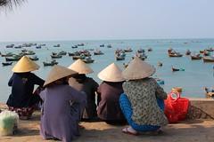 (Bantamgirl) Tags: old boats fishing women waiting harbour ne vietnam overlooking crouching mui coolie fishwives
