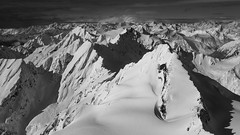 I'm on top of the world! (beaugraph) Tags: newzealand bw snow mountains alps blackwhite air flight aerial mtcook southisland southernalps aoraki canon6d sigmaart50